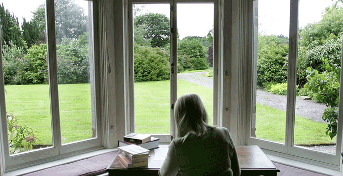 Tyrone-Guthrie-Fellow-Working-in-Window-CROPPED